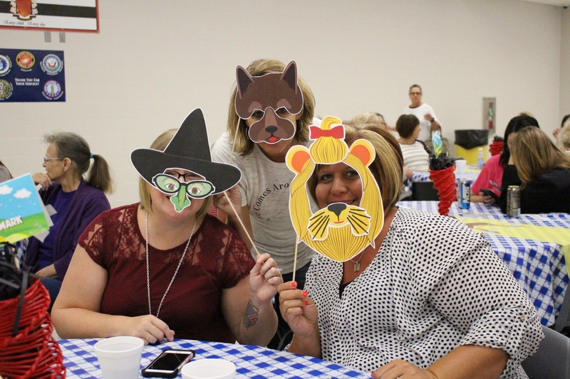 RSD employees pose with wizard of oz photo props at Back to School Breakfast.